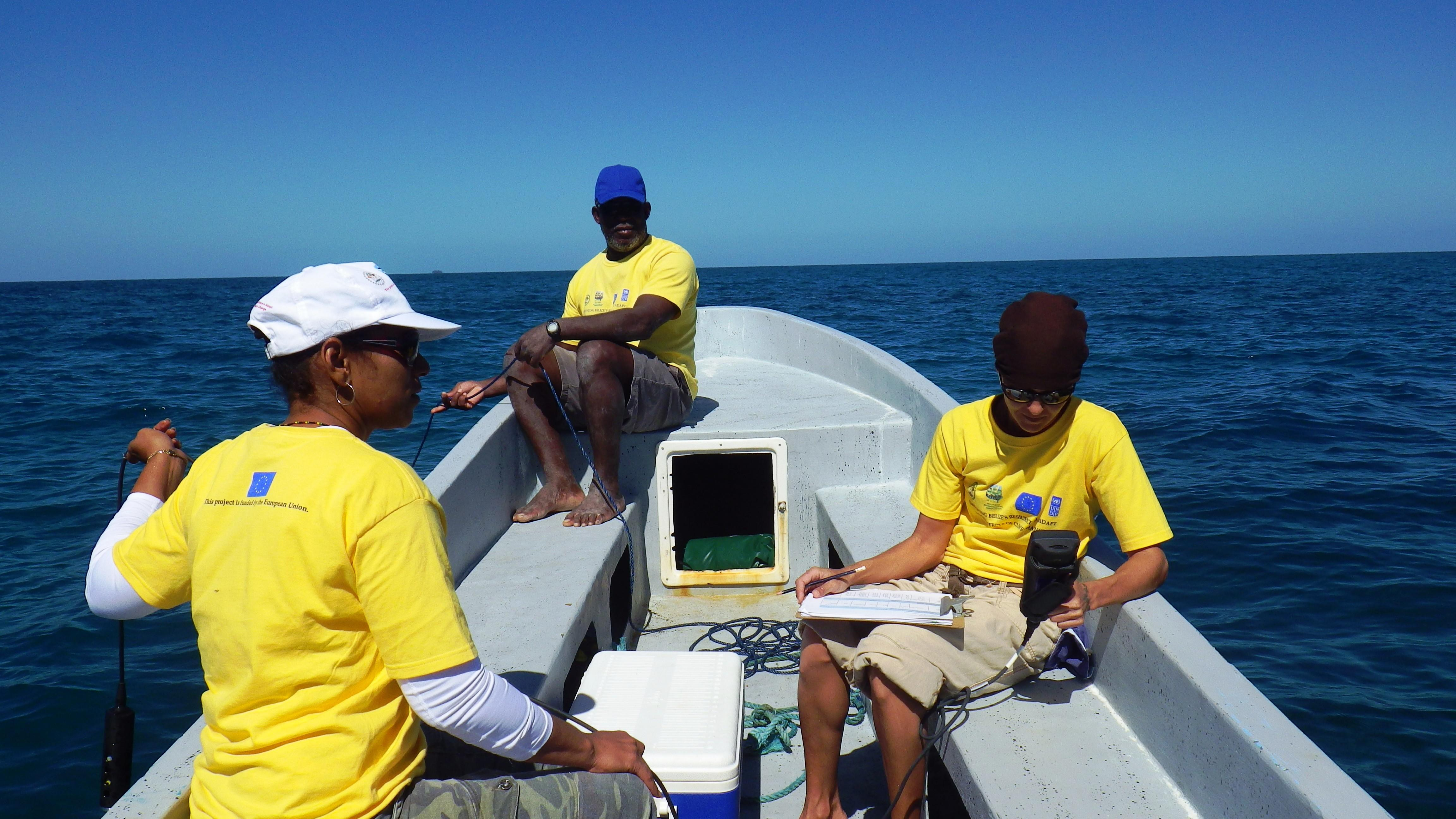 A volunteer and local experts take a boat trip to gather some data whilst on a diving and marine conservation work experience project in Belize with Projects Abroad.